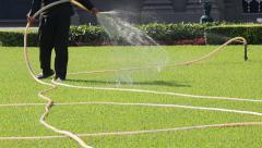 Man Watering On Beautiful Green Lawn Stock Footage