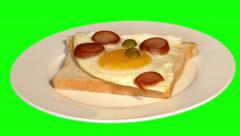 4k opened sandwich with fried egg and sausages on plate Stock Footage