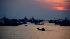 Fisherman boats drifting in the ocean at sunset Stock Footage