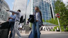 Tourists in Docklands, London, UK - stock footage