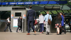 Canary Wharf London Underground station and commuters Stock Footage