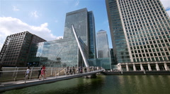Business commuters heading into Docklands, London - stock footage