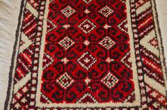 Stock Photo of Small wool rug with red background