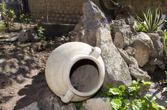 Stock Photo of Old the clay pitcher in garden