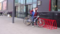 Man Park Bike at the Bicycle Parking on Lock Stock Footage