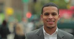 Young African American black Latino man in city smile face portrait - stock footage