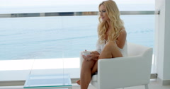 Blond woman on the balcony of a luxurious hotel Stock Footage