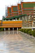 pavement gold    temple   in   bangkok  reflex - stock photo