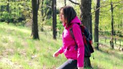 Young woman trekking through the forest HD Stock Footage