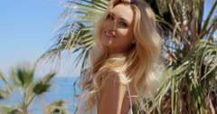 Close Up of Blond Woman in Tropical Location Stock Footage
