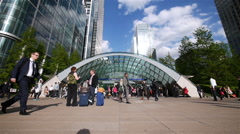 Canary Wharf tube station and commuters, London, UK - stock footage