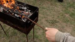 Man mixing firewood in grill mangal Stock Footage