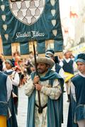 Banner of the medieval house in the parade on the day of the Palio Stock Photos
