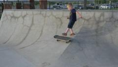 Child trying to skate board. Stock Footage