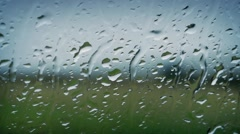 Rain On Window Looking Out At Nature Stock Footage