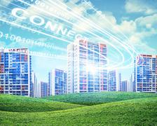 Cityscape under cloudy blue sky - stock illustration