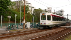 Light rail train drive away, to the station stop Stock Footage