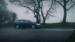 Cars On Rural Road In Fog And Rain Stock Footage