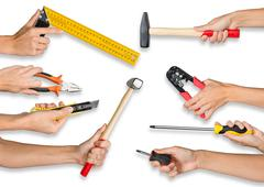 Set of peoples hands holding tools - stock photo