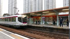 Trolley car arriving at station - open platform, chinese town Stock Footage