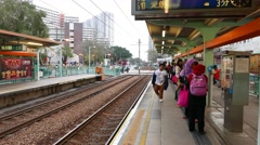 Boy and Muslim girls waiting train on station, Light Rail Transit Stock Footage
