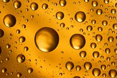 golden water drops - stock photo