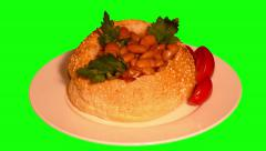 4k hamburger bun full of beans in tomato sauce with vegetables Stock Footage