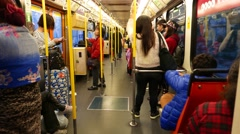 Inside tramway train, moving in dusk area, people travelling at evening time Stock Footage