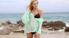Blond Woman in Bikini and Cover Up on Rocky Beach Stock Footage