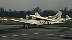 England 1960s: Piper aircraft parking in the runway Stock Footage