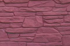 Masonry wall of red stone Stock Photos