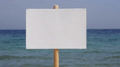 Protest sign against the backdrop of a seascape Stock Footage