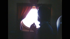 Vintage 16mm film, DC6 woman at window in flight, 1960 Stock Footage