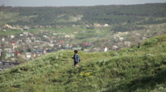 Boy running down the hill Stock Footage
