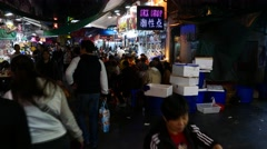Chinese sex shop sign on crowded night street - open air restaurant Stock Footage
