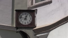 Old clock on the street with footsteps in background, Bolzano - Bozen Stock Footage