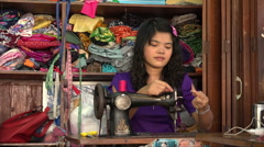 Woman using sewing machine in Scott Market in Rangoon, Burma, Yangon, Myanmar Stock Footage