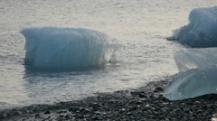 Iceberg moving in water at coast Stock Footage