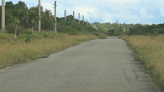 Single Lane Road in Tropical Island of Guam Stock Footage