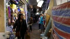 Aisle at night market, narrow passage, POV walking through - stock footage