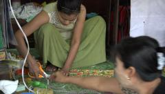 Women making clothes in Scott Market in Rangoon, Burma, Yangon, Myanmar Stock Footage