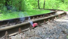 Smoldering fuse bundles of dynamite on the railroad. Stock Footage