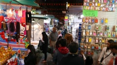 Bijouterie and souvenirs at the night market, overhead view, move forward Stock Footage
