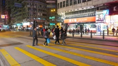 Few people and then young couple crossing night city street, with alert sound Stock Footage