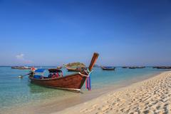 Longtail boat and beautiful ocean of Koh Lipe island, Thailand Stock Photos