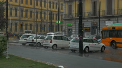 Pouring rain Naples Italy street traffic bus driving away - 4K UHD 0225 - stock footage
