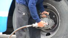 Thai men change of wheel tires Stock Footage