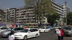Apartment block street scene in Rangoon, Burma, Yangon, Myanmar Stock Footage