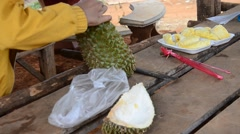 Greengrocer peel durian fruit Stock Footage
