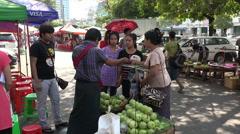 Women buy fruits from Street food stall in Rangoon, Burma, Yangon, Myanmar Stock Footage
